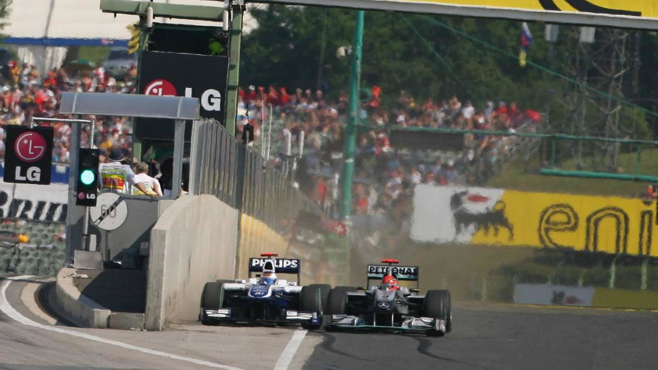 Rubens Barrichello (BRA), Williams F1 Team and Michael Schumacher (GER), Mercedes GP Petronas - Formula 1 World Championship, Rd 12, Hungarian Grand Prix