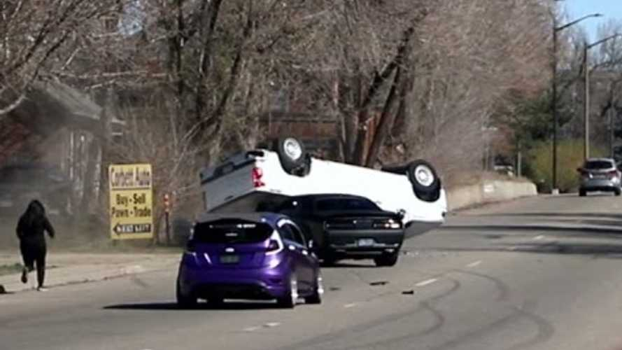 Challenger Hellcat tries to show off, ends up flipping pickup
