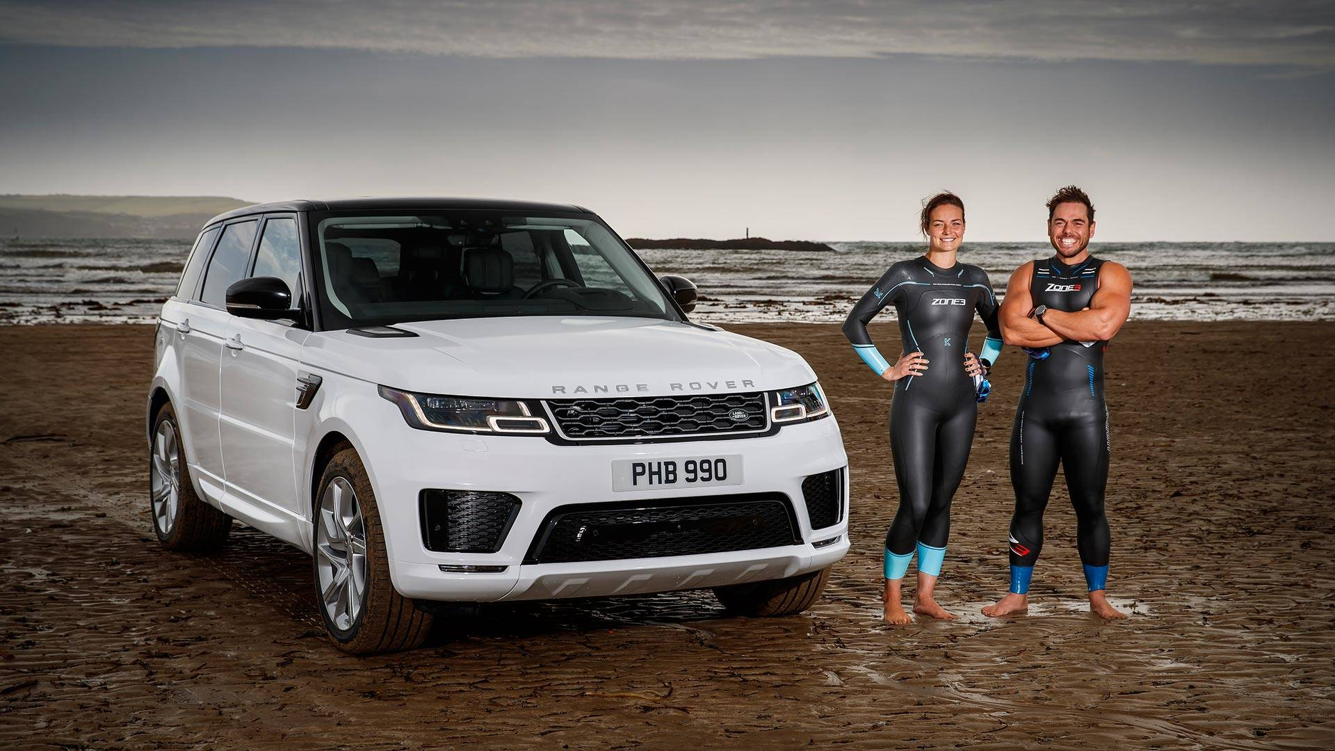 Range Rover Sport Phev Wades Into The Sea Races Pro Swimmers