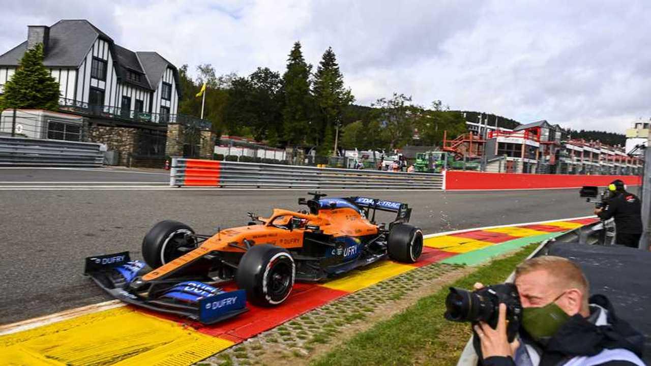 Carlos Sainz Jr., McLaren MCL35, passes a photographer
