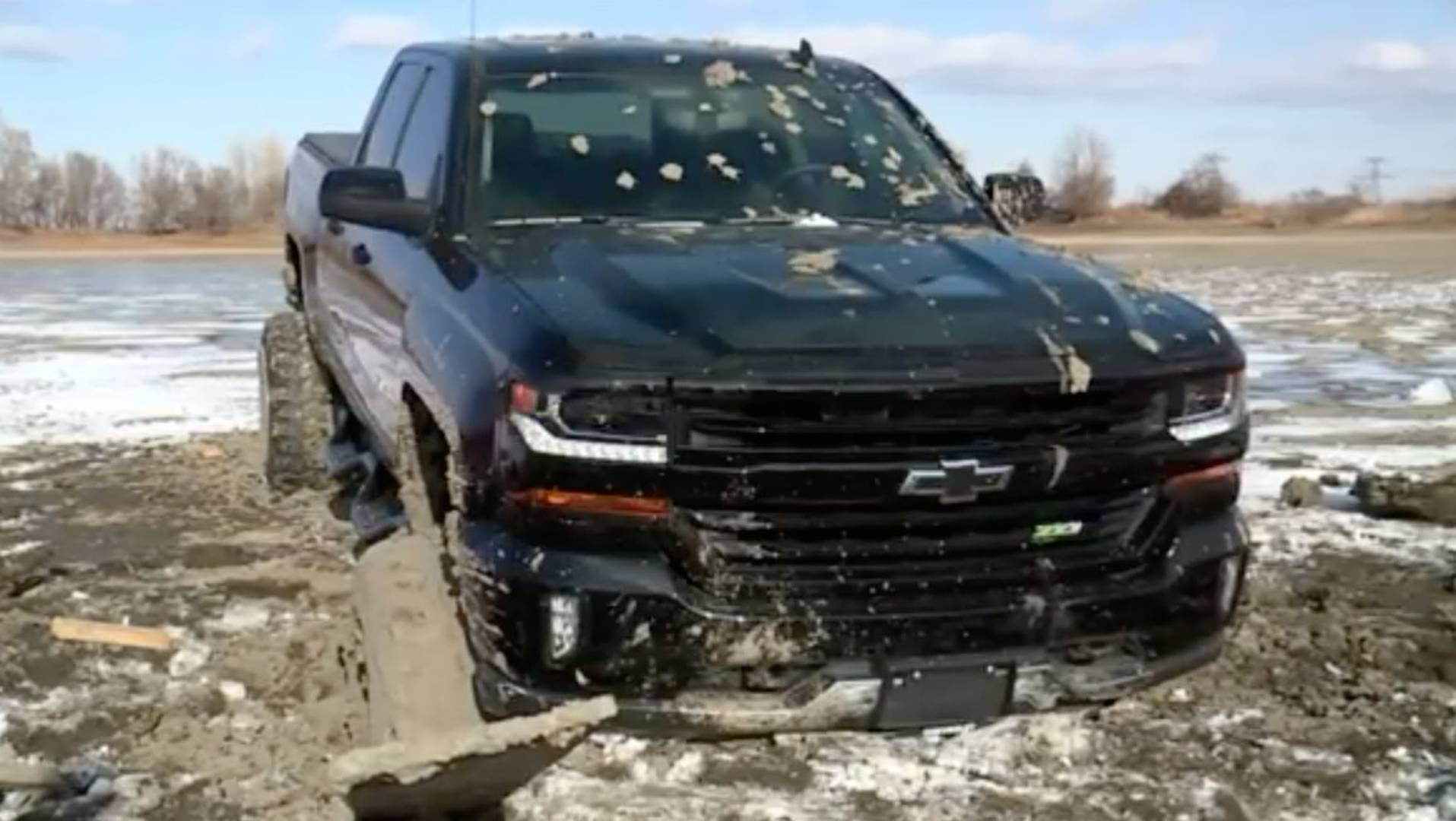 Chevy Silverado And Rescuing Backhoe Get Stuck In Frozen Lake