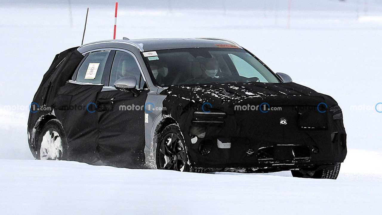 Genesis GV70e spy photos lead image