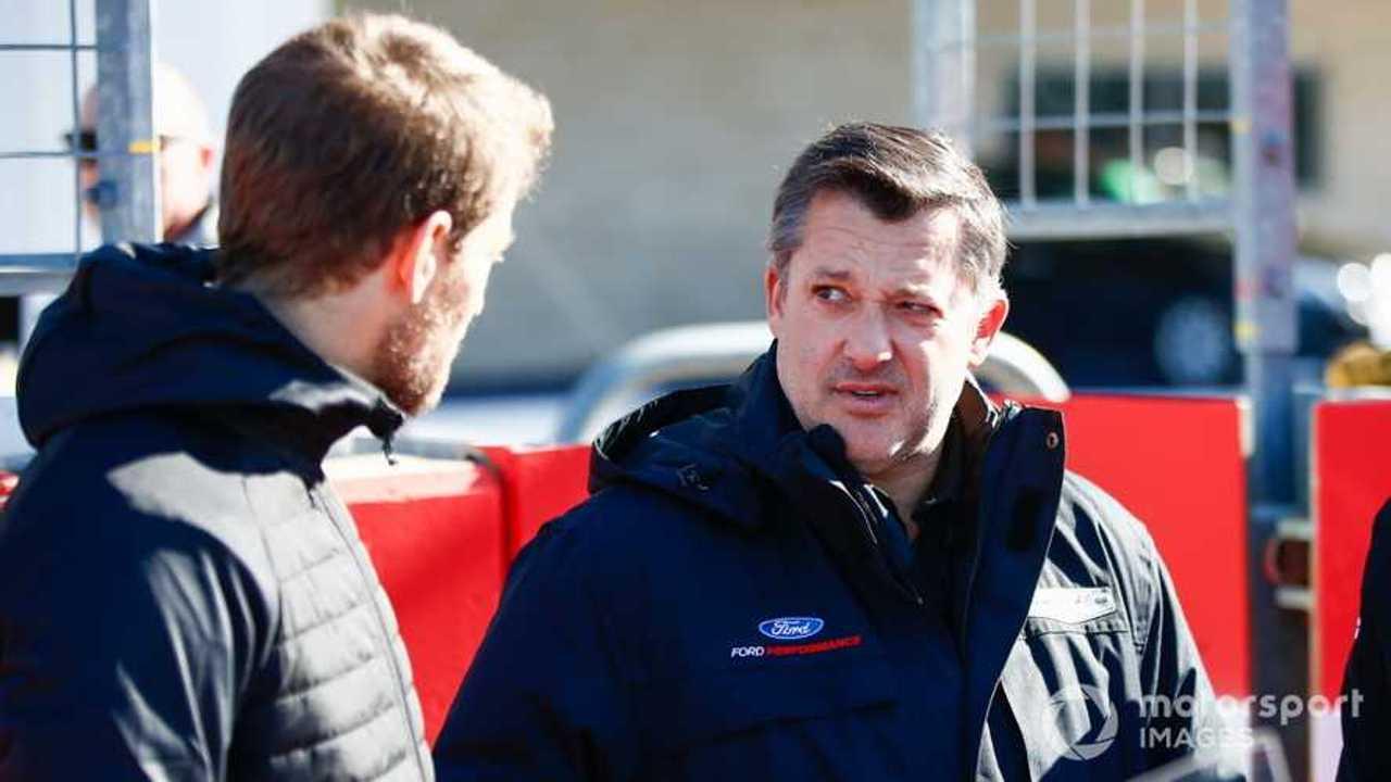 NASCAR Cup driver Tony Stewart talks to Romain Grosjean