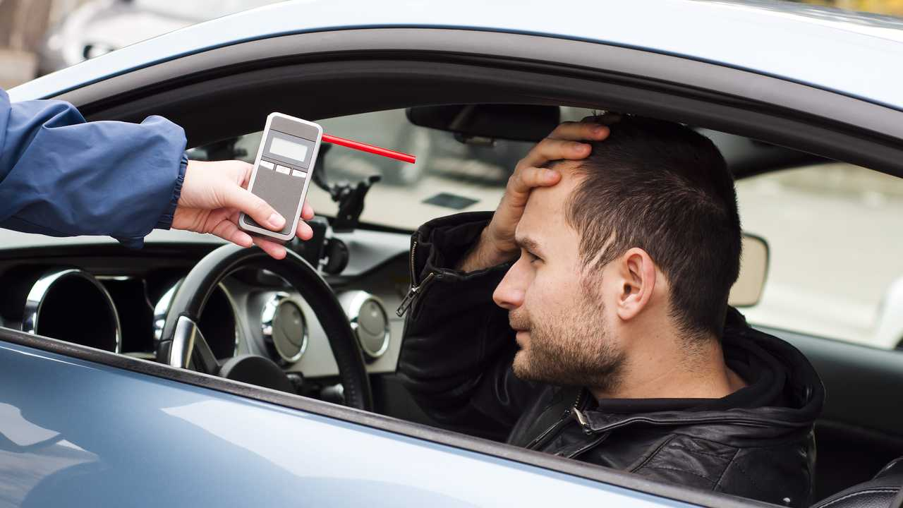 Worried man before taking breathalyser test for alcohol