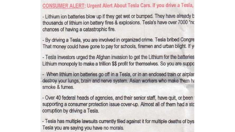 Anonymous Consumer Alert Fliers Found On Tesla Model S