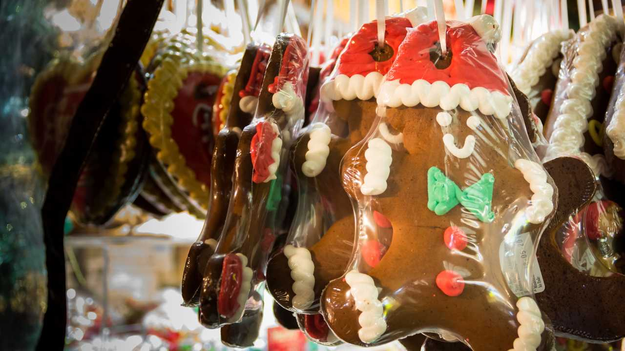 Plastic wrapped gingerbread men hanging in Christmas market