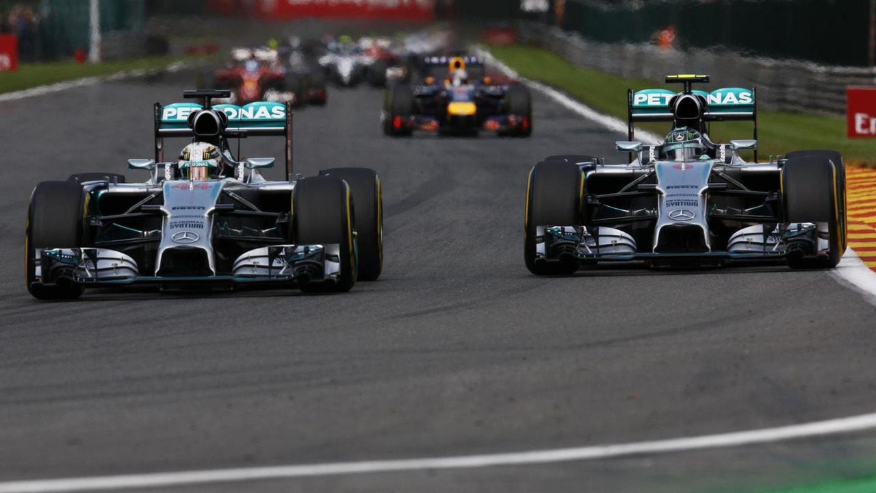 Lewis Hamilton (GBR) and team mate Nico Rosberg (GER) battle for position shortly before making contact, 24.08.2014, Belgian Grand Prix, Spa Francorchamps / XPB