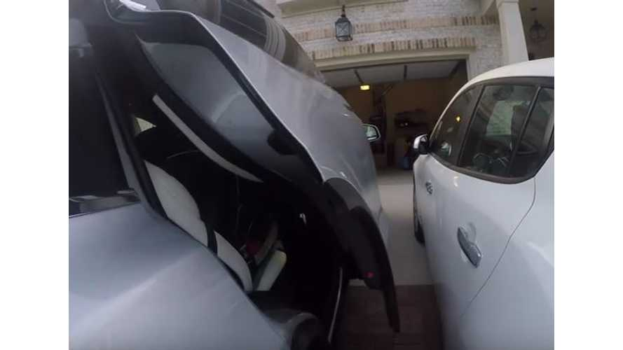 Tesla Model X Falcon Door Versus Nissan LEAF - Video