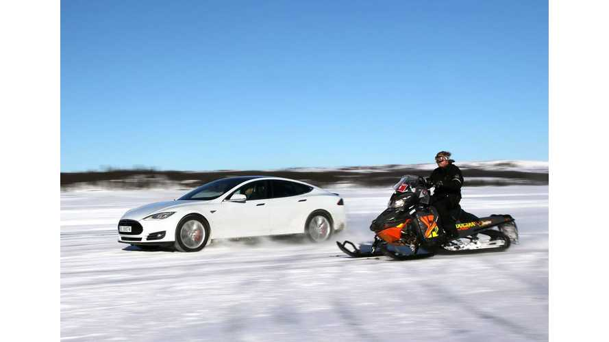Tesla Model S P85D Races Snowmobile On Iced-Over Lake - Video