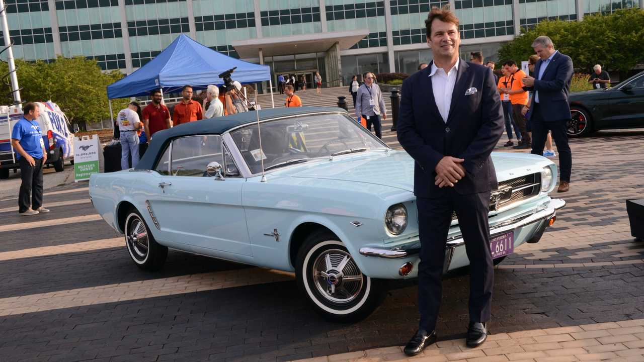 Ford CEO Jim Farley with a first-generation Mustang Convertible