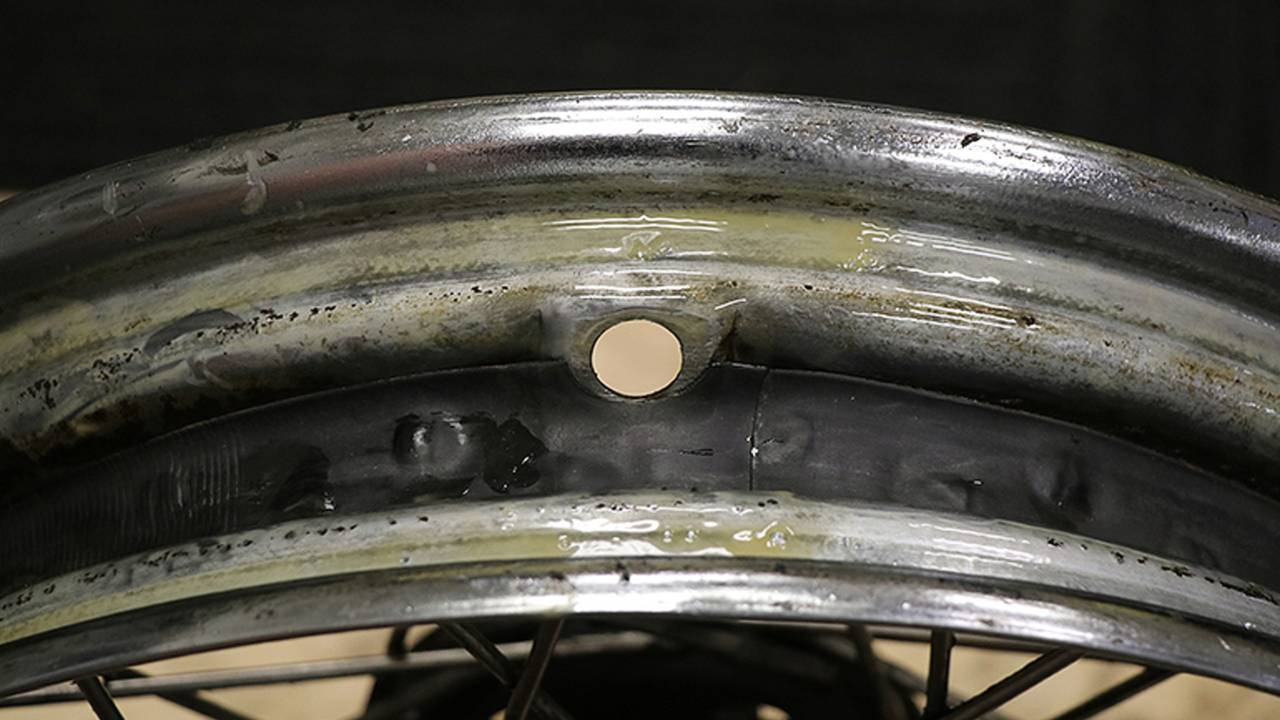<em>Line up the notch in the rim strip with the hole for the valve stem in the rim.</em>
