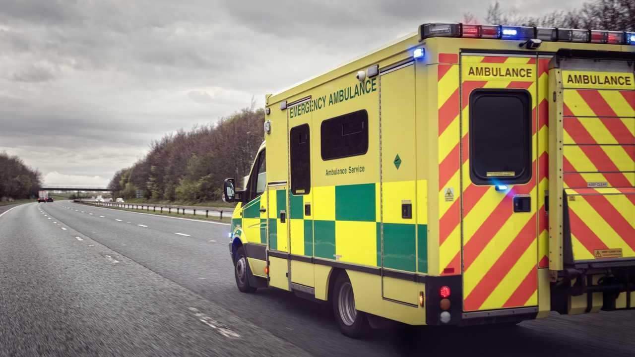 British ambulance responding to an emergency on UK motorway