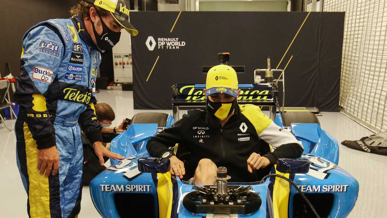 Fernando Alonso, Renault F1 Team with the 2005 Renault R25 and Esteban Ocon, Renault F1 Team