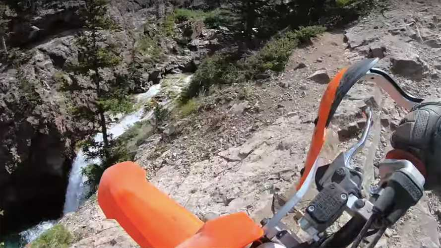 Watch This Guy Tumble Off a Cliff With His Bike And Fall Into A River