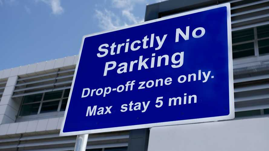 Strictly no parking airport sign drop off zone only at Heathrow London