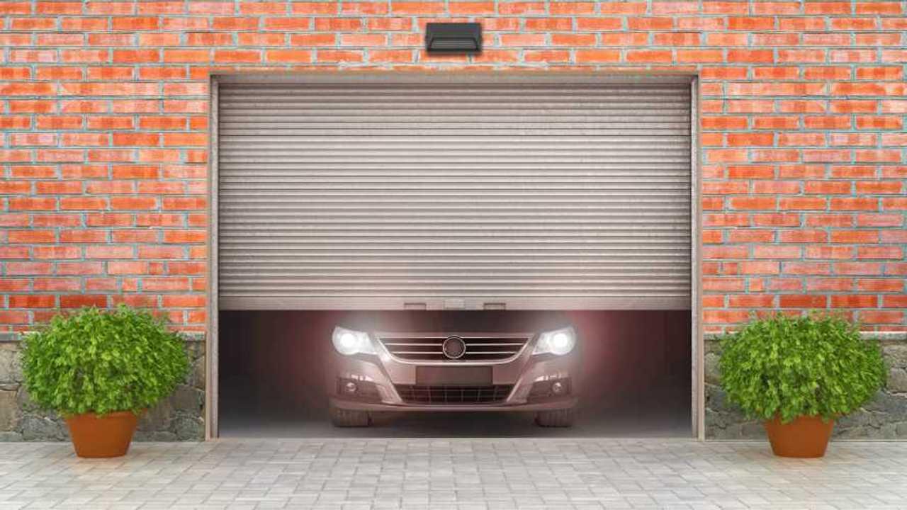 Car behind opening garage door