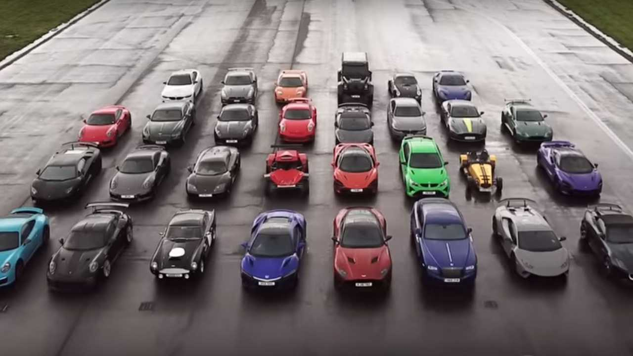 watch lots of cars drag race on wet top gear test track. Black Bedroom Furniture Sets. Home Design Ideas