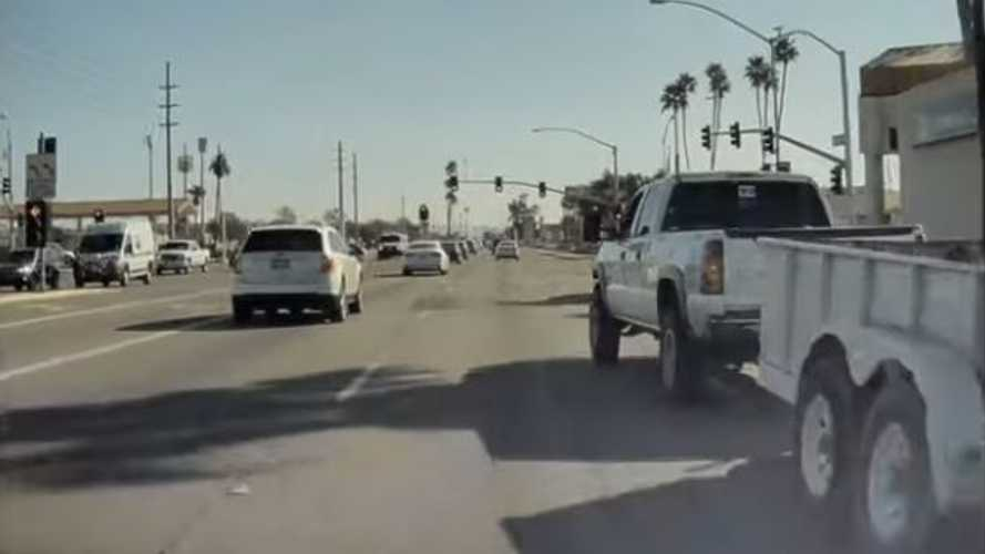Watch Trailer-Towing Truck Cut Off A Tesla: Truck Driver Flicks Finger