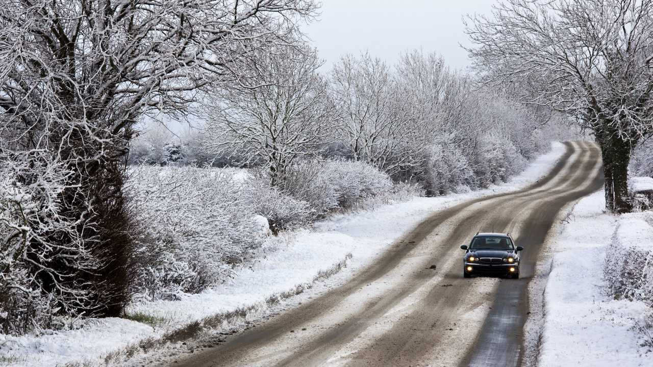 Winter snow driving on a country road in North Yorkshire UK