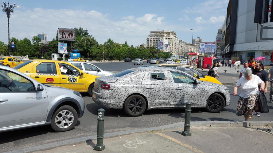 New Renault Laguna spied heavily camouflaged in Romania