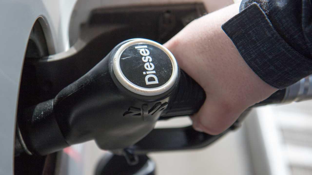 Pumping diesel fuel at petrol station