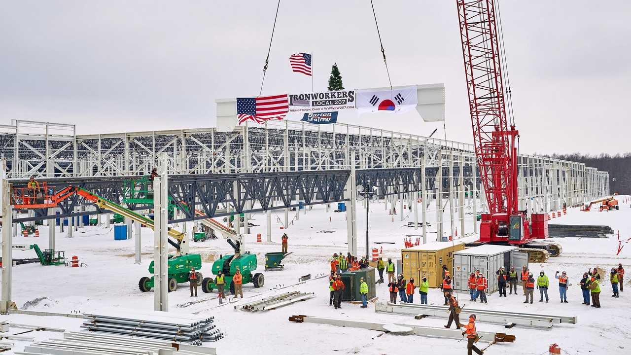 Ironworkers at Ultium Cells LLC's battery cell manufacturing facility mark a construction milestone Friday, Feb. 19, 2021 with the final beam installation at what will soon be a 2.8-million-square-foot operation in Lordstown, Ohio.