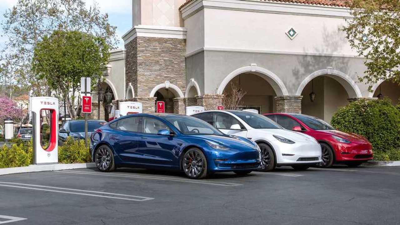 Tesla Model 3 charging at a Tesla Supercharging station