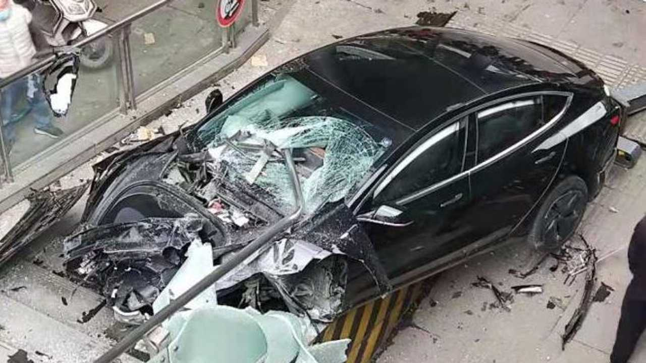 A Tesla Model 3 Hits An Electric Bike Then Crashes In China