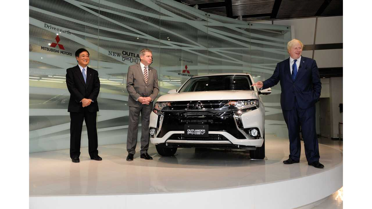 Mitsubishi Chairman and CEO Osamu Masuko, UK Managing Director Lance Bradley and Mayor of London, Boris Johnson at the 2016 Mitsubishi Outlander PHEV unveiling in Tokyo.