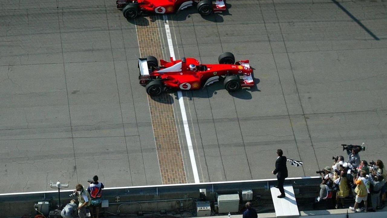 Michael Schumacher, Rubens Barrichello cross finish line together, 2002 SAP United States Grand Prix, 29.09.2002 Indianapolis, USA