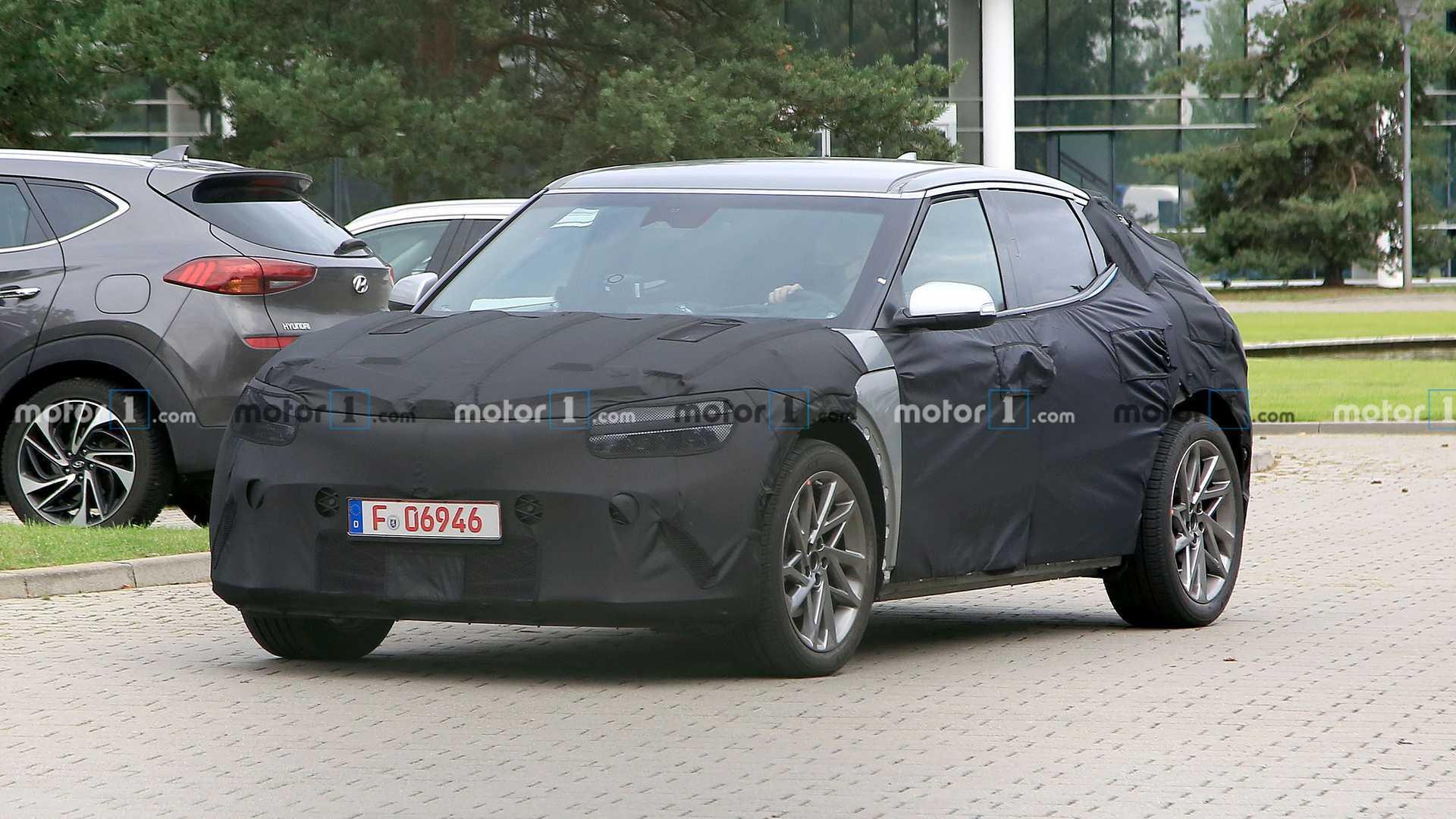 2021 - [Genesis] EV Hyundai-jw-ev-spy-shots-camo-front-three-quarters