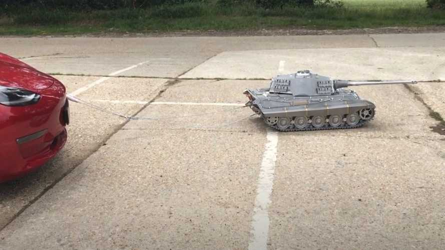 Watch This Tiny Tank Tug And Tow A Tesla Model 3
