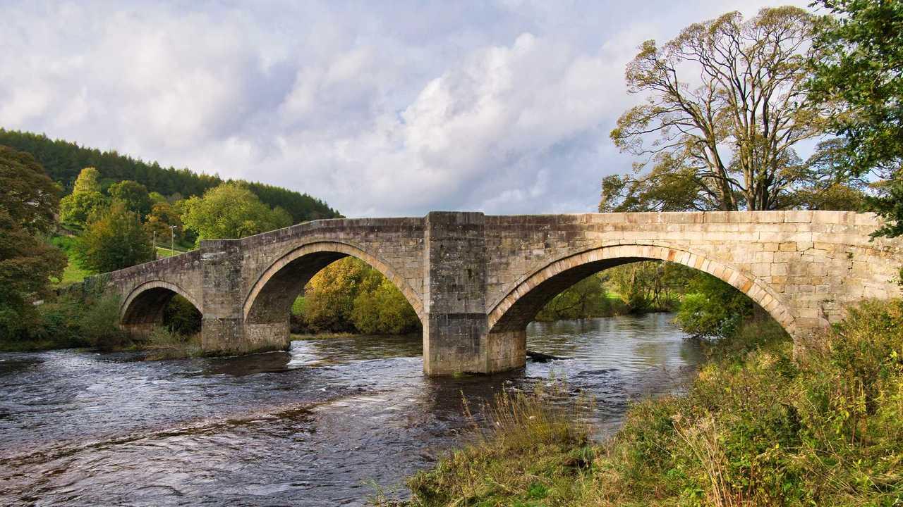 Barden Bridge across the River Wharfe in Yorkshire Dales UK
