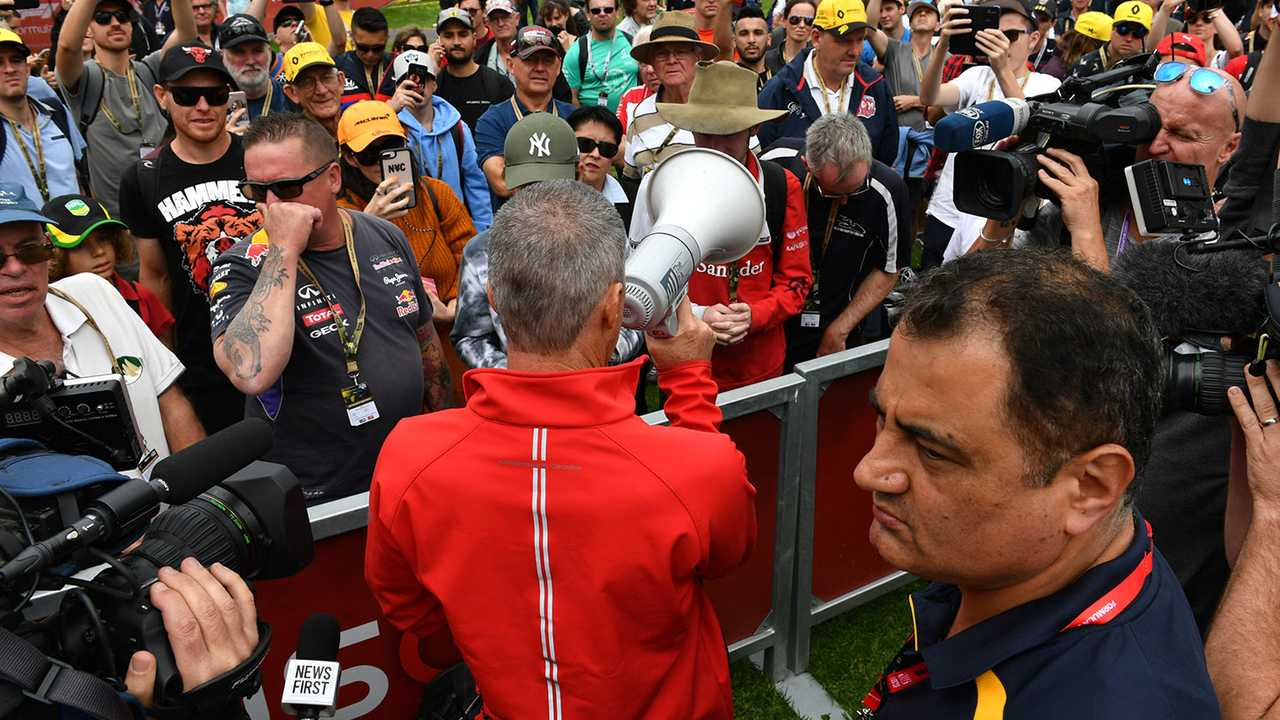 A member of the Australian Grand Prix Corporation makes an announcement to fans