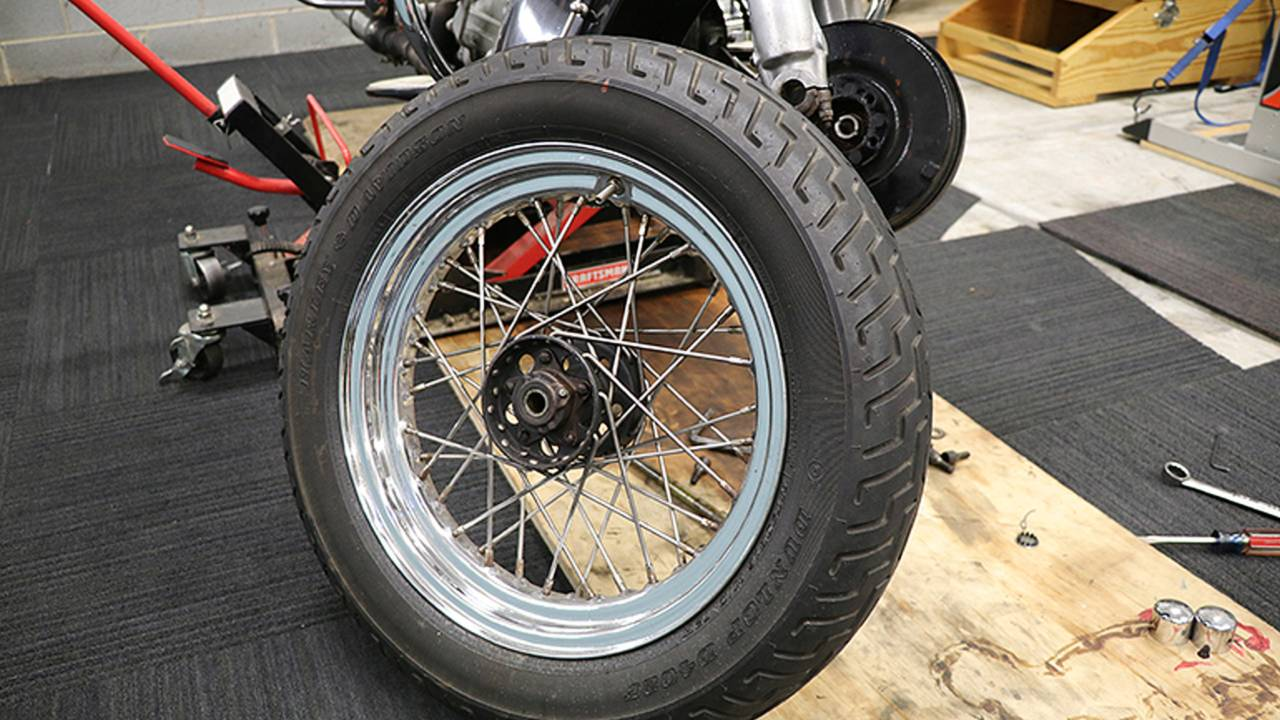 <em>Whenever you are lifting a motorcycle off the ground, make sure to secure it properly once it is in the air.</em>