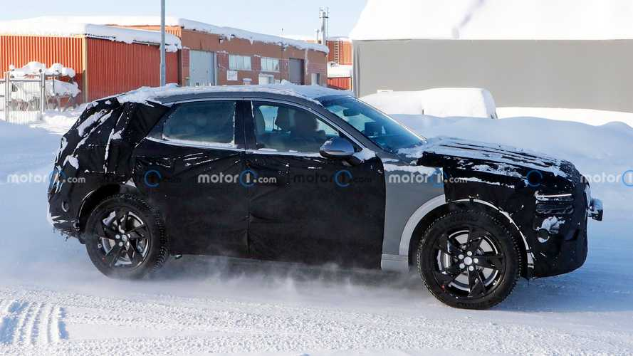 Genesis GV70e Spied Refusing To Drop Camouflage