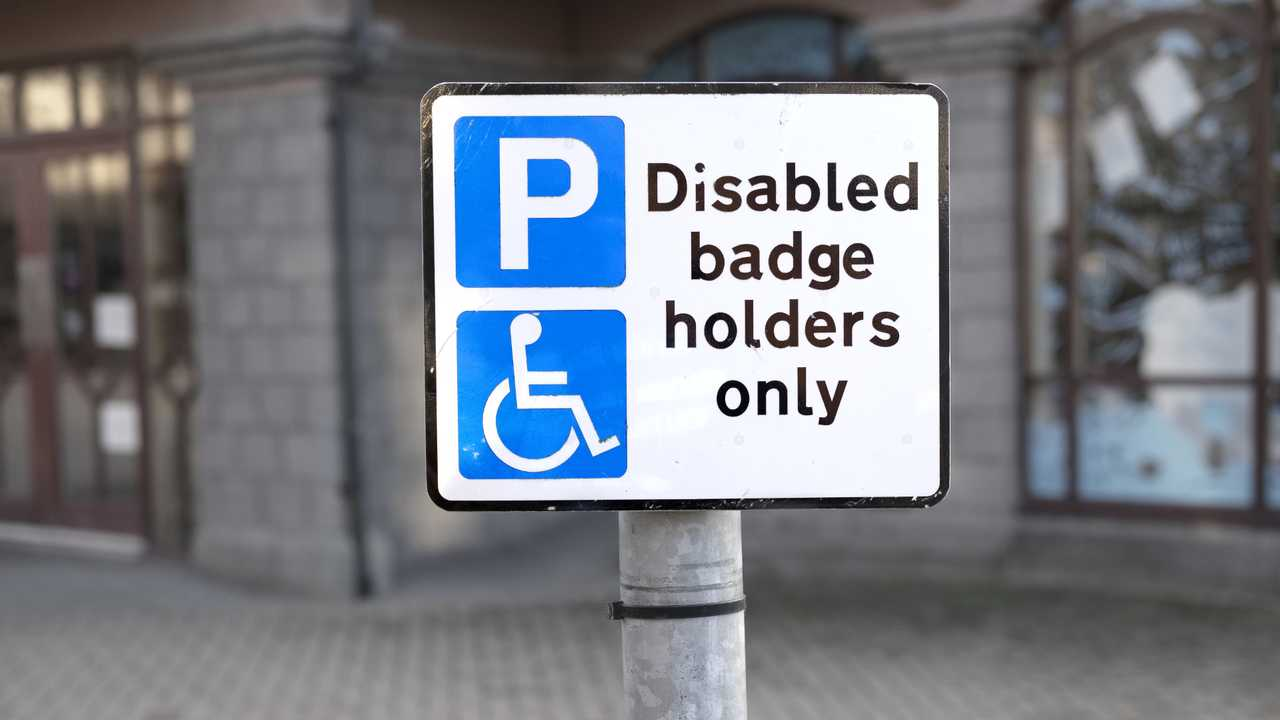 Disabled badge holders only at car park sign post