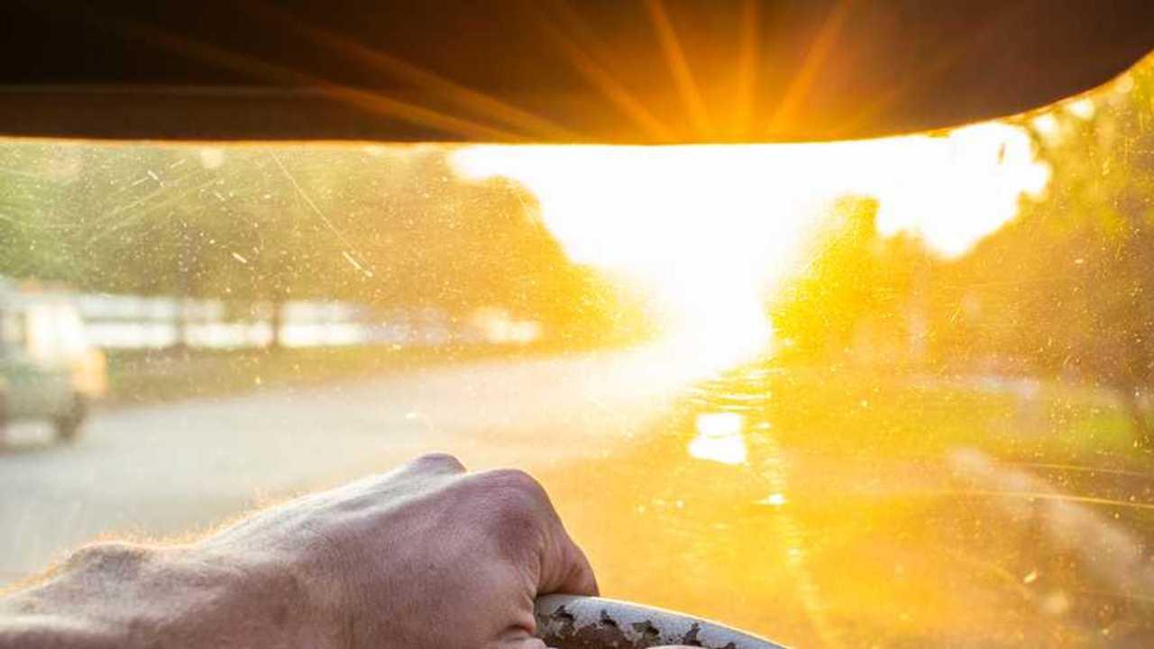 Driver facing blinding sun through car windscreen