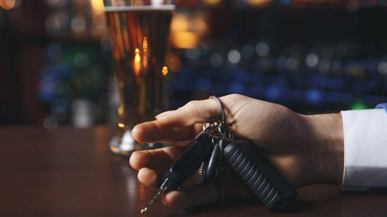 Man at pub drinking beer talking car keys