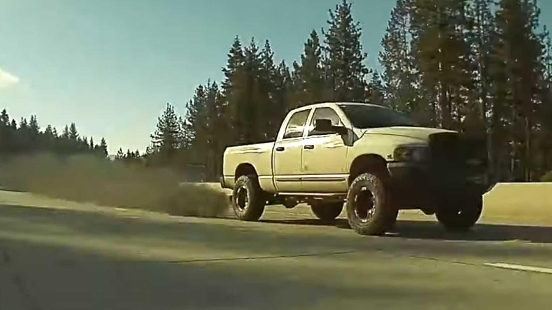 Tesla Model 3 Leaves Coal-Rolling Ram Pickup Truck In The Dust: Video