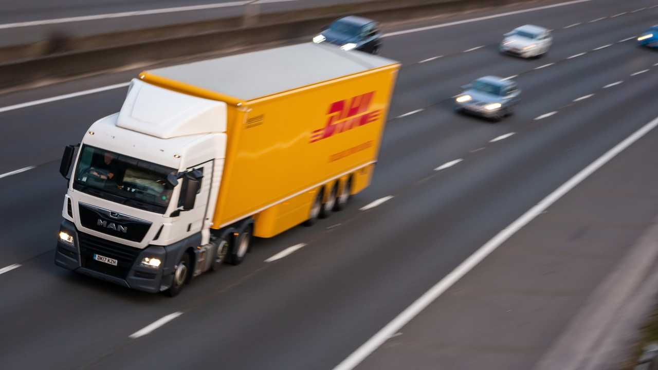 DHL lorry on British motorway M1 in Luton UK