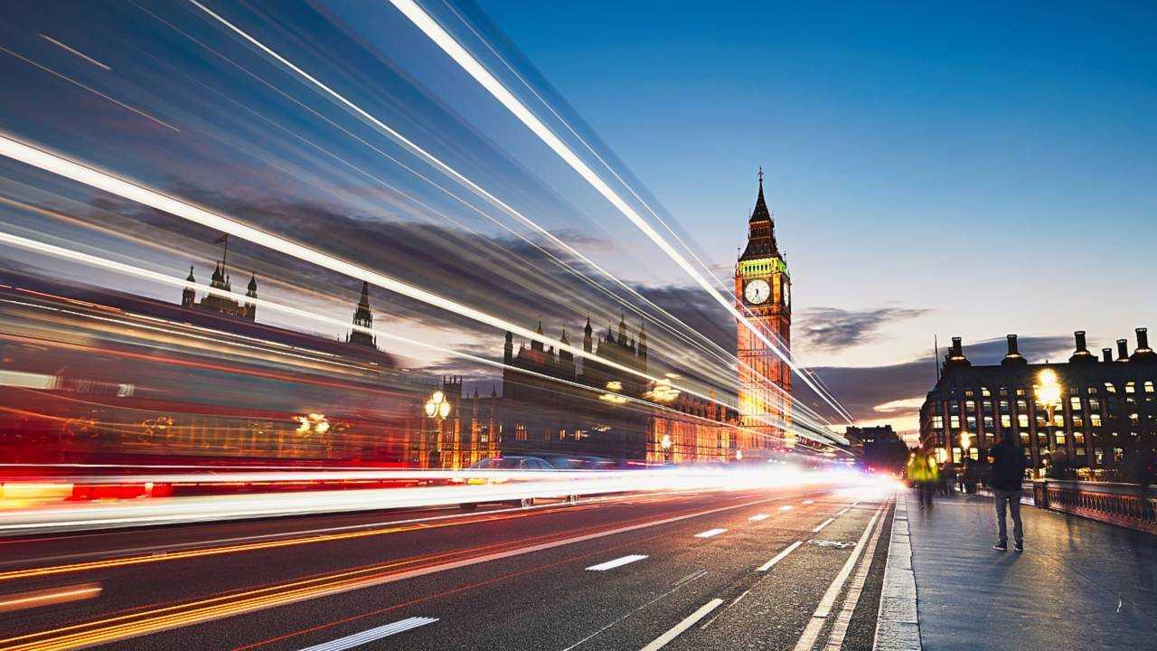 Traffic light trails on Westminster bridge after sunset