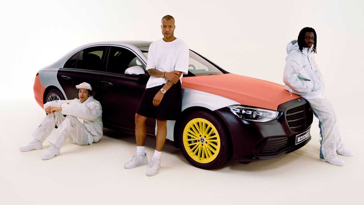 People wearing inflatable clothes made from airbags pose with a new Mercedes-Benz .