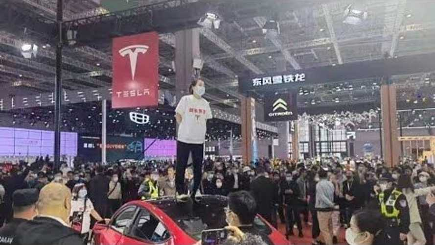 Tesla owner protests at Shanghai Auto Show, standing on a Tesla