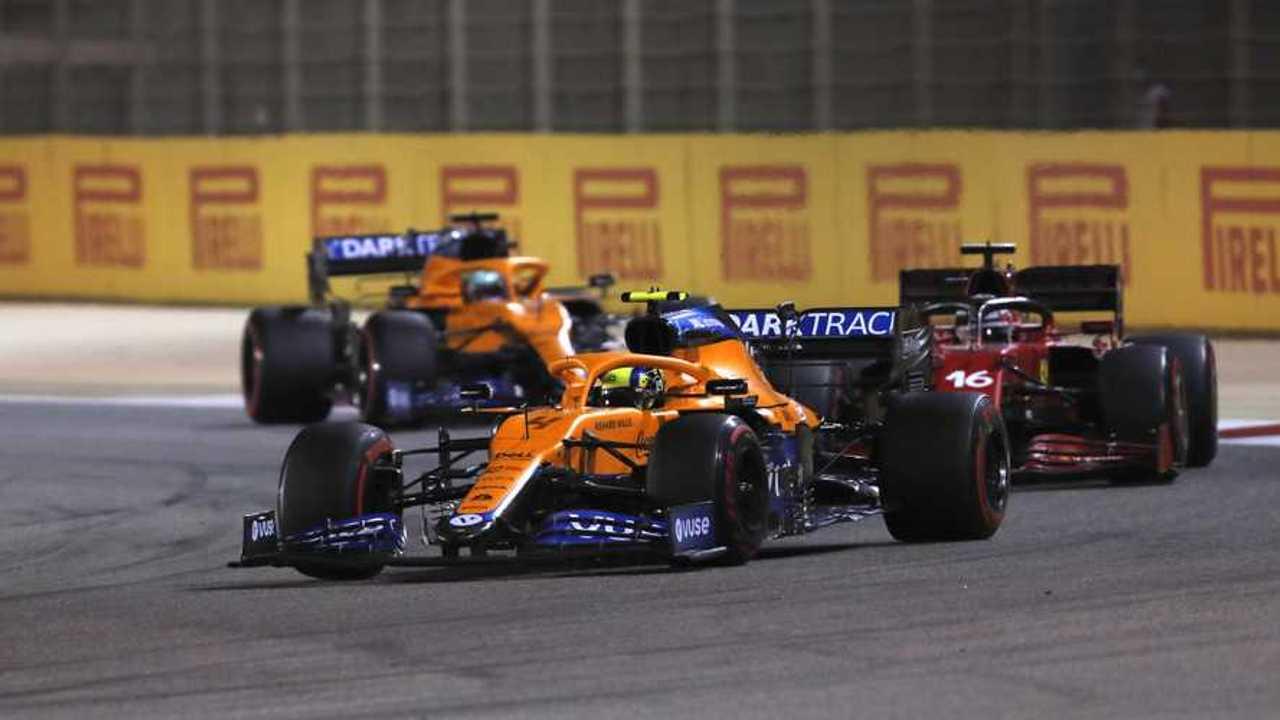 Lando Norris, McLaren MCL35M, Charles Leclerc, Ferrari SF21, and Daniel Ricciardo, McLaren MCL35M
