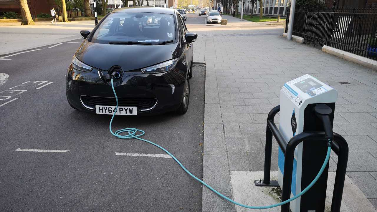 Renault Zoe electric vehicle charging on the street of Coventry City Centre