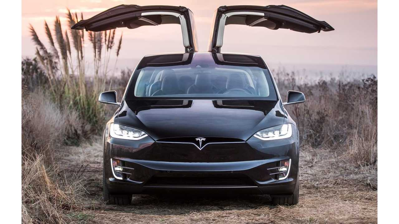 Tesla Model X with falcon wing doors aloft.