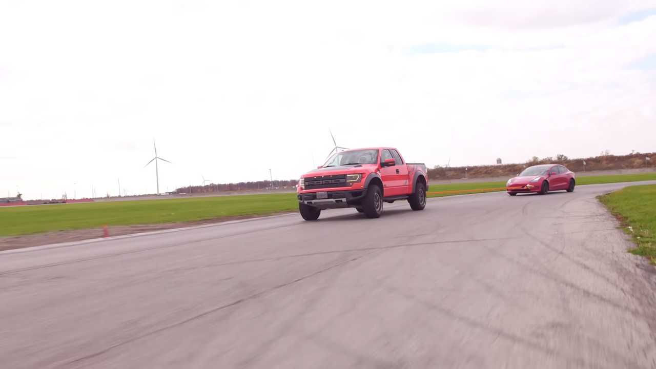 Ford Raptor Charges A Tesla Model 3 By Towing It