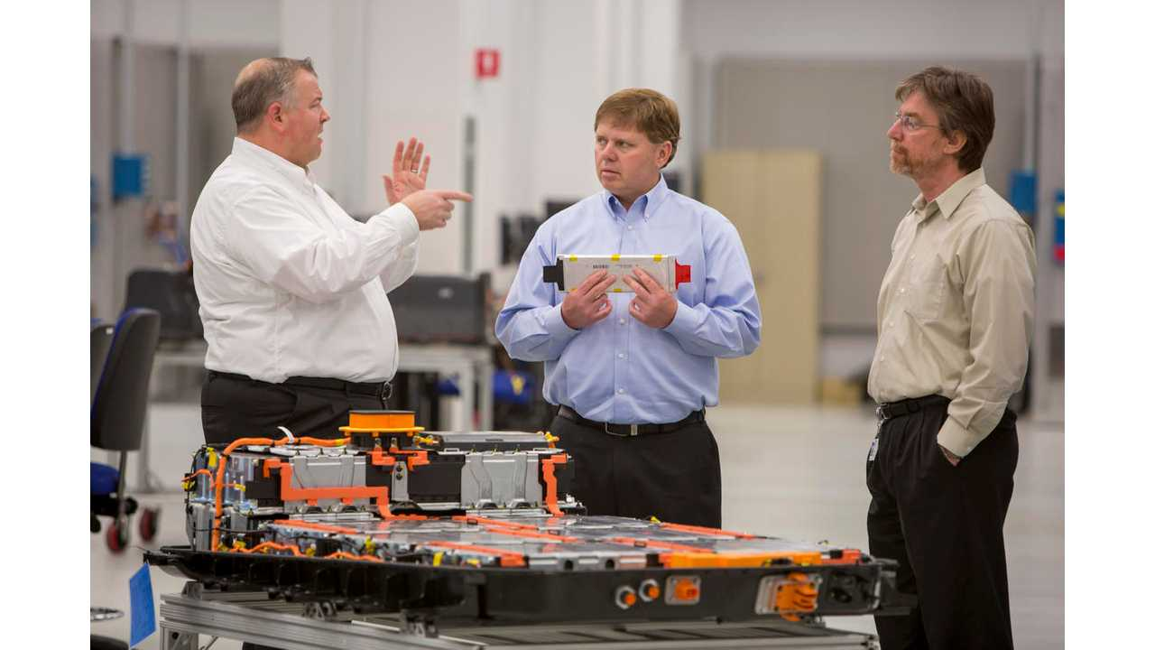 Greg Smith, Engineering Group Manager, Electrification, left, Tim Grewe, General Director, Electrification, center, and Stephen Poulos, Global Chief Engineer, Electrification, right, discuss their work with a Chevrolet Bolt EV battery pack in General Motors Global Battery Systems Laboratory at the GM Technical Center in Warren, Michigan, Tuesday, April 5, 2016. (Photo by Jeffrey Sauger for General Motors)