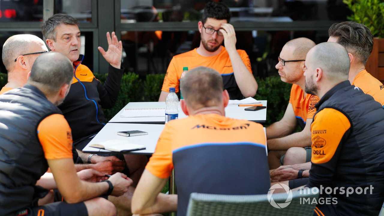Members of the McLaren team hold a meeting in the Australian GP 2020 paddock